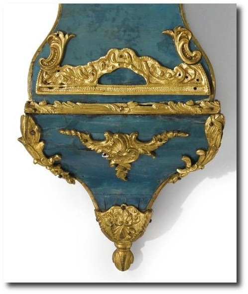 A Louis XV ormolu-mounted green-stained horn small cartel clock circa 1745, the dial signed D. F. Dubois a Paris