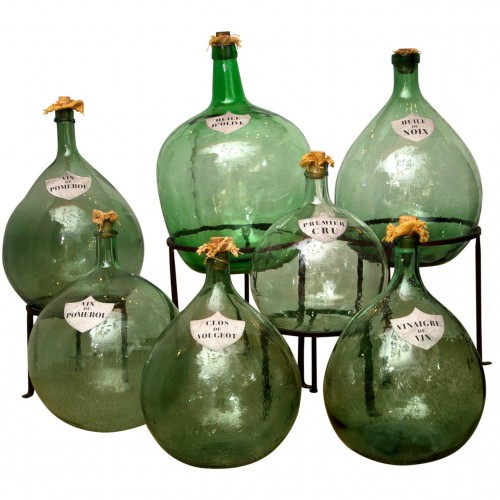 A Collection of French Green Glass Demijohns