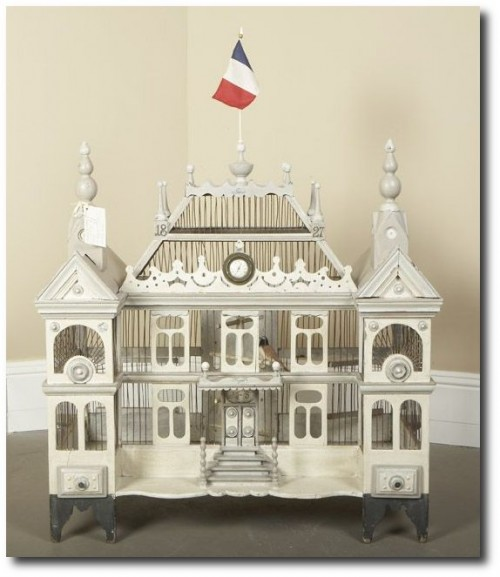 Pretty White French bird cage complete with the French flag and decorative finials - Lamaisonfou Blog