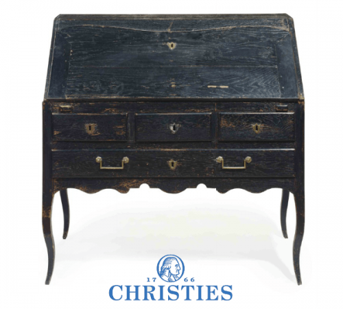 A FRENCH PROVINCIAL EBONIZED OAK SLANT-FRONT BUREAU